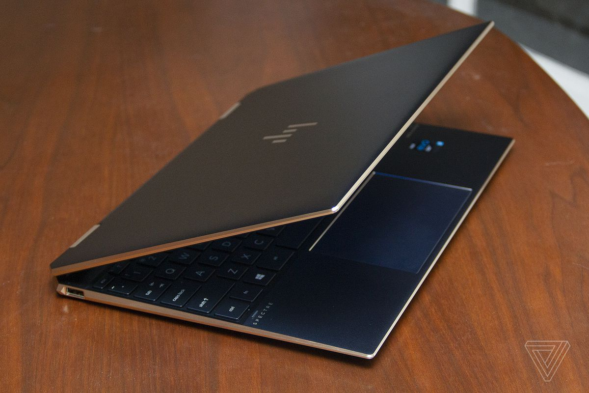 The HP Spectre x360 angled to the right, seen from above, with the lid half closed.