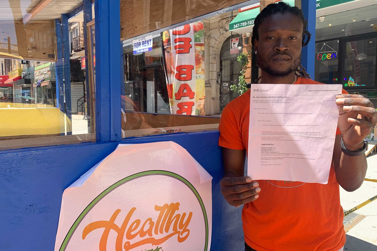 Pachillo Archille, owner of Healthy Vibe in Crown Heights, says the city cleared him to open an outdoor dining structure in a bus lane along Nostrand Avenue, June 16, 2021.