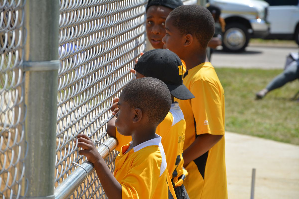 Boys watch the action at Excell Walker Field on Friday.   John Fountain/For the Sun-Times