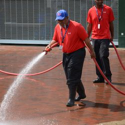 2:57 p.m Ballpark facilities crew washing down the area outside of Gate D, at Addison and Sheffield -
