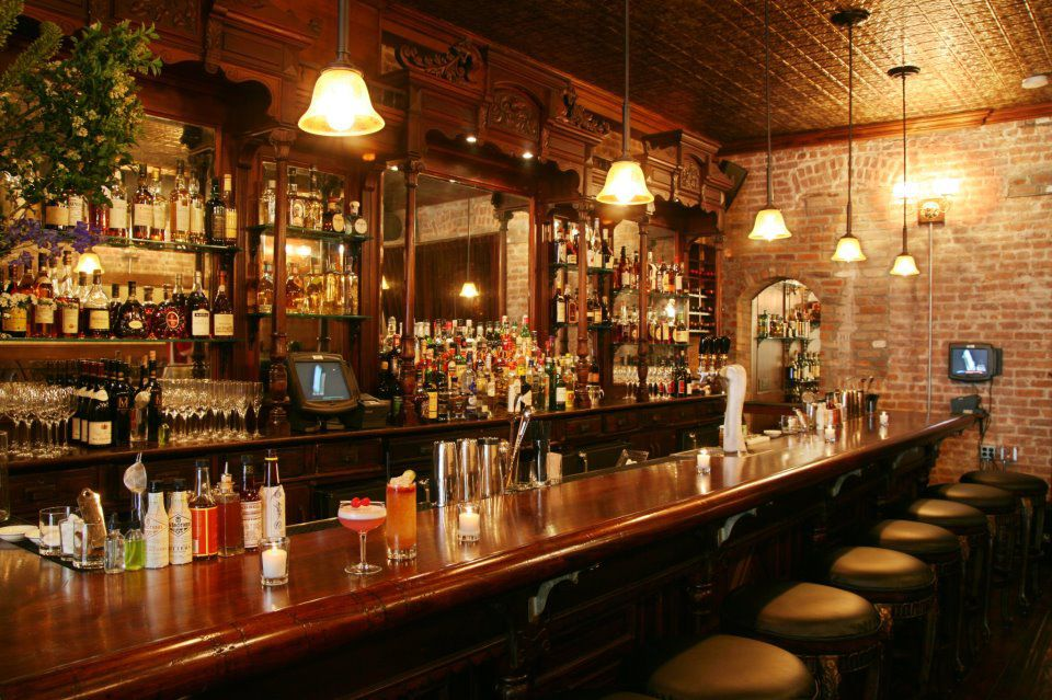 The main bar at Clover Club sits fallow before evening service, with lights hanging above