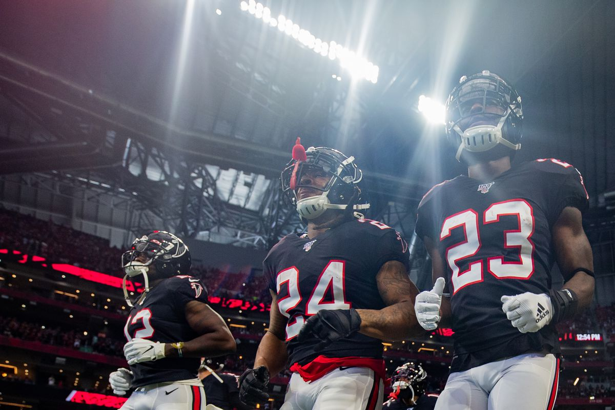 Devonta Freeman and Brian Hill of the Atlanta Falcons run onto the field prior to the start of the game against the Tennessee Titans at Mercedes-Benz Stadium on September 29, 2019 in Atlanta, Georgia.