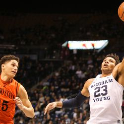 Brigham Young Cougars forward Yoeli Childs (23) hauls in a long pass in front of Idaho State Bengals forward Kyle Ingram (35) during the first half as BYU takes on Idaho State at the Marriott Center in Provo on Thursday, Dec. 21, 2017.