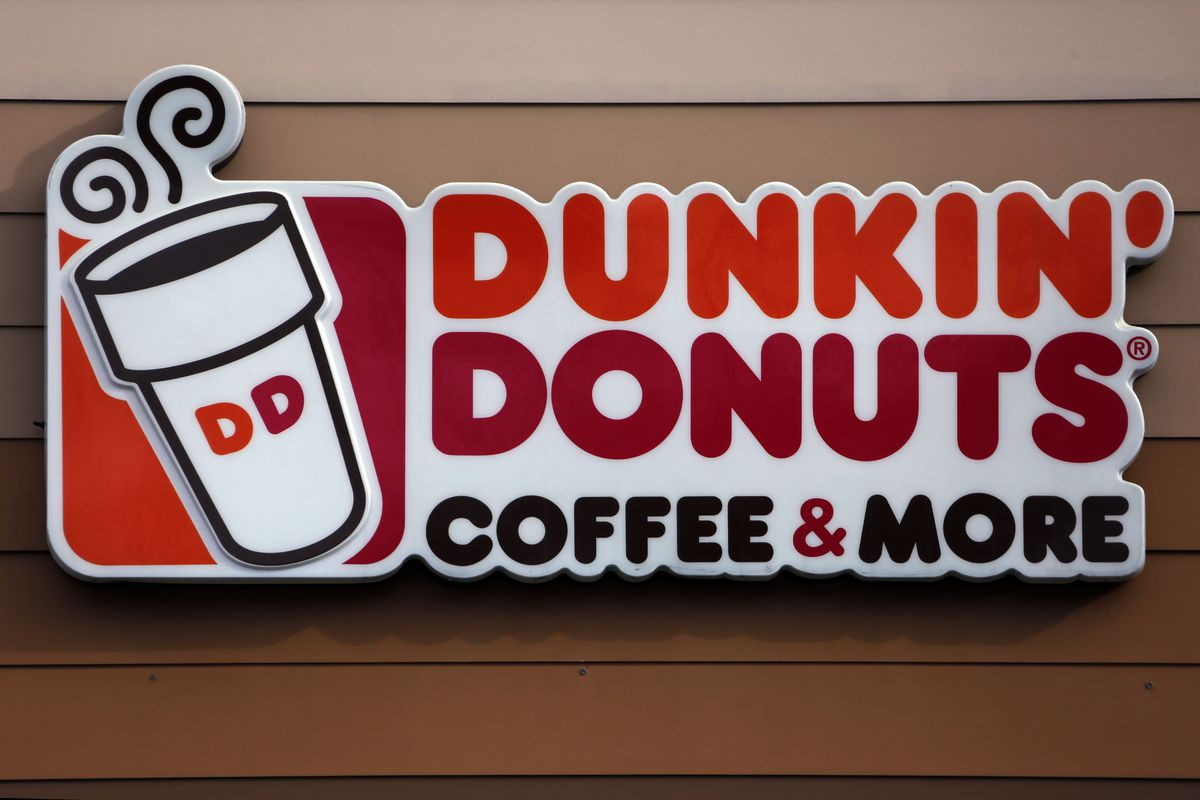 This Jan. 22, 2018, photo shows the Dunkin' Donuts log on a shop in Mount Lebanon, Pa. Massachusetts-based Dunkin' Donuts announced an updated menu on Friday, July 27, which is featuring the company's first gluten-free product - a fudge brownie.