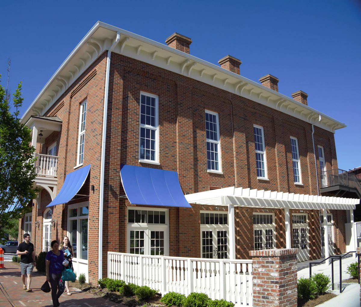 The two-story brick building in which Carson Kitchen resides at Alpharetta City Center