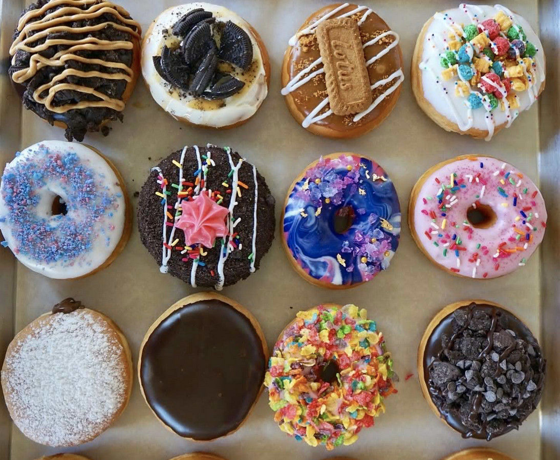 An assortment of colorful doughnuts in a box