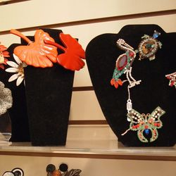 Jeweled brooches.
