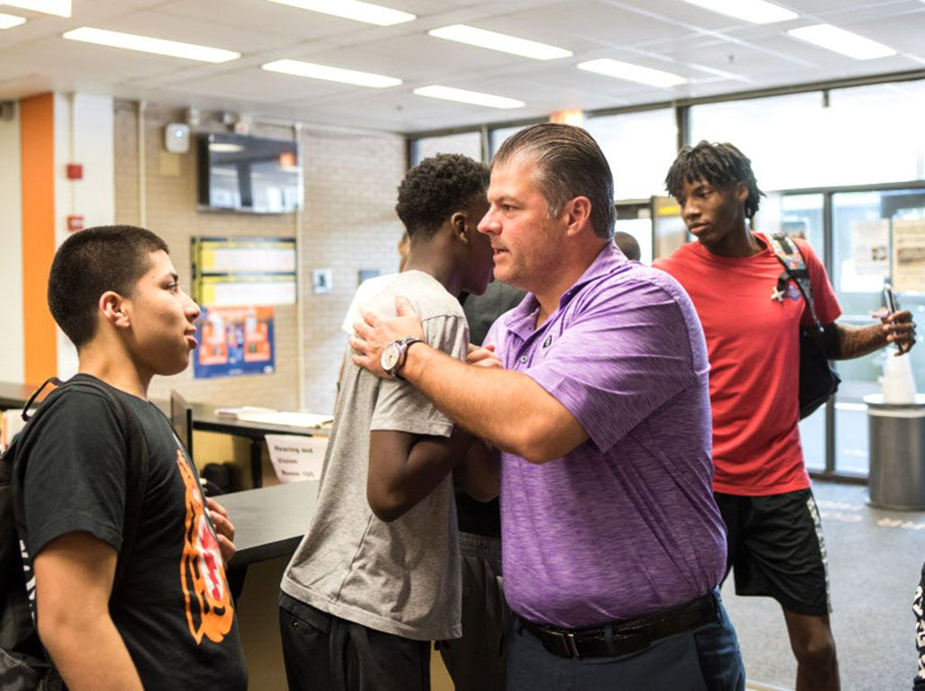 Chicago businessman John Kelly meets with members of the Orr Academy basketball team. | Max Herman/For the Sun-Times