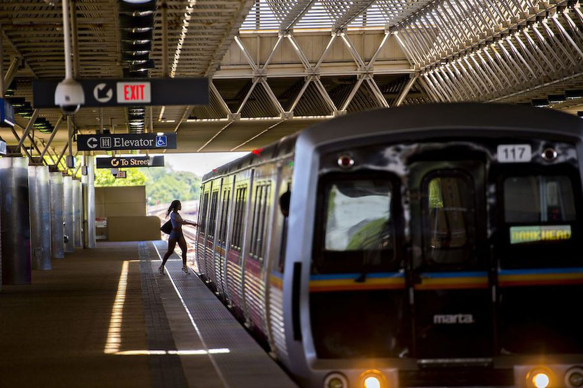 A rider boards a MARTA train at King Memorial Station in Atlanta.