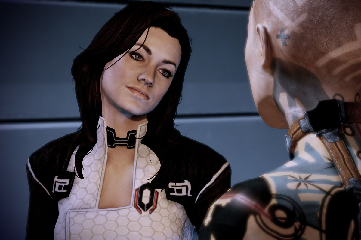 Miranda having a conversation, her head is kind of tilted and she has a slight smile