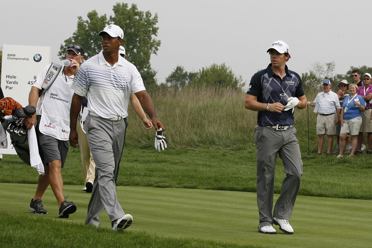 Sep 7, 2012; Carmel, IN, USA; Tiger Woods (left) and Rory McIlroy (right) walk down the 8th fairway during the second round of the BMW Championship at Crooked Stick Golf Club. Mandatory Credit: Brian Spurlock-US PRESSWIRE