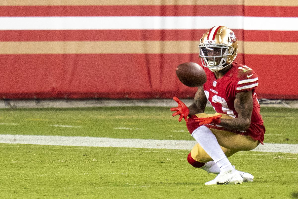 San Francisco 49ers wide receiver Richie James (13) catches the football for a touchdown against the Green Bay Packers during the fourth quarter at Levi's Stadium.