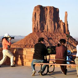 Visitors photograph Monument Valley Navajo Tribal Park in northeastern Arizona. A study shows about 600,000 visitors made nearly $113 million in direct purchases on the Navajo Nation's reservation in 2011.