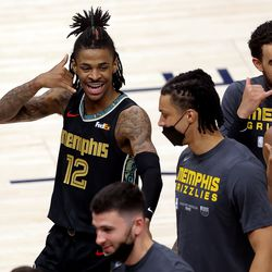 Memphis Grizzlies guard Ja Morant (12) other teammates celebrate as they defeat the Utah Jazz in game one of their NBA playoff series at Vivint Arena in Salt Lake City on Sunday, May 23, 2021. Memphis won 112-109.