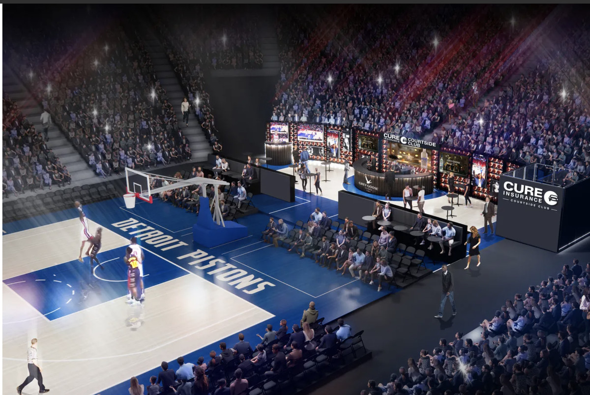 Rendering of a bar behind the visiting team basket at Little Caesars. It has branding from CURE Insurance.