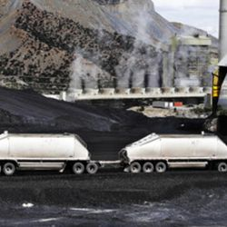 A truck dumps coal at the Huntington power plant in Huntington, Tuesday, March 24, 2015.