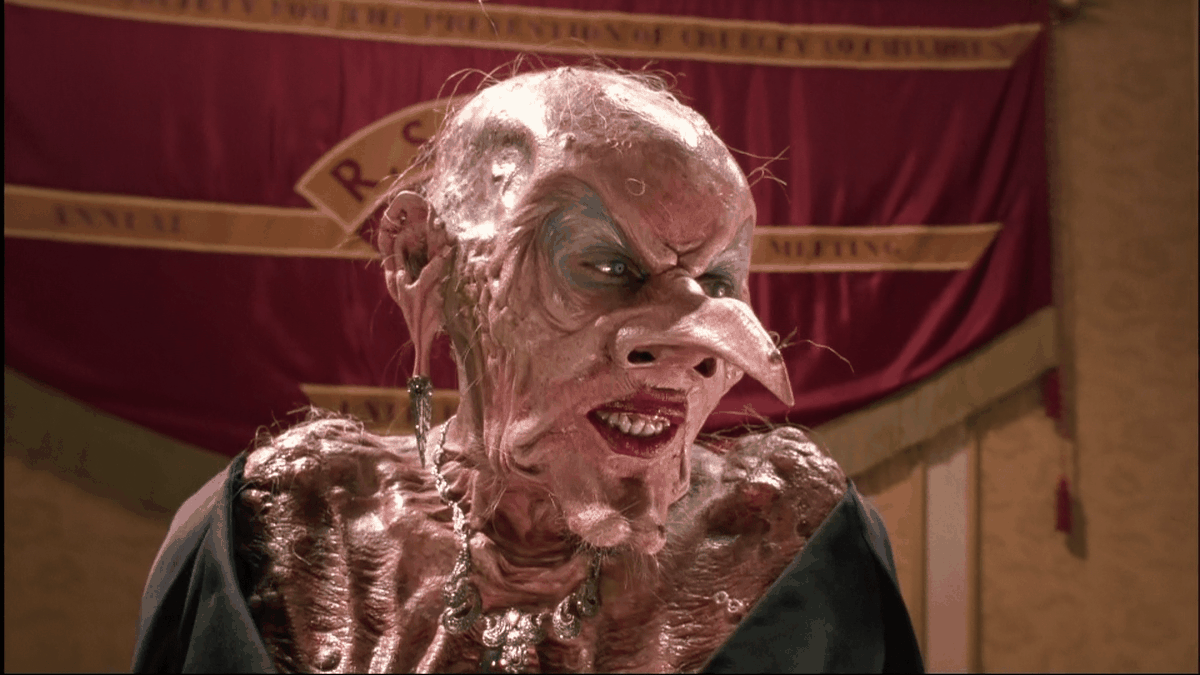 Anjelica Houston as a hideous, bald, huge-nosed witch in The Witches