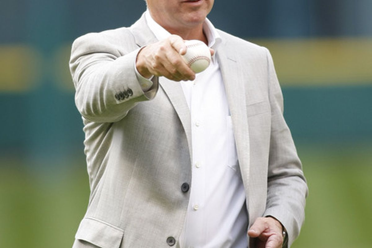 Apr 6, 2012; Houston, TX, USA; Houston Astros owner Jim Crane throws out the first pitch before a game against the Colorado Rockies at Minute Maid Park on Opening Day. Mandatory Credit: Brett Davis-US PRESSWIRE