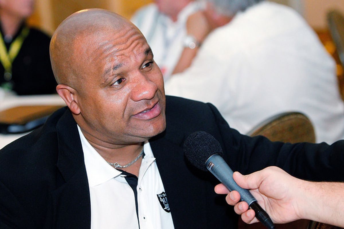 Hue Jackson takes a timeout from his rec hall bingo to answer some question about football.