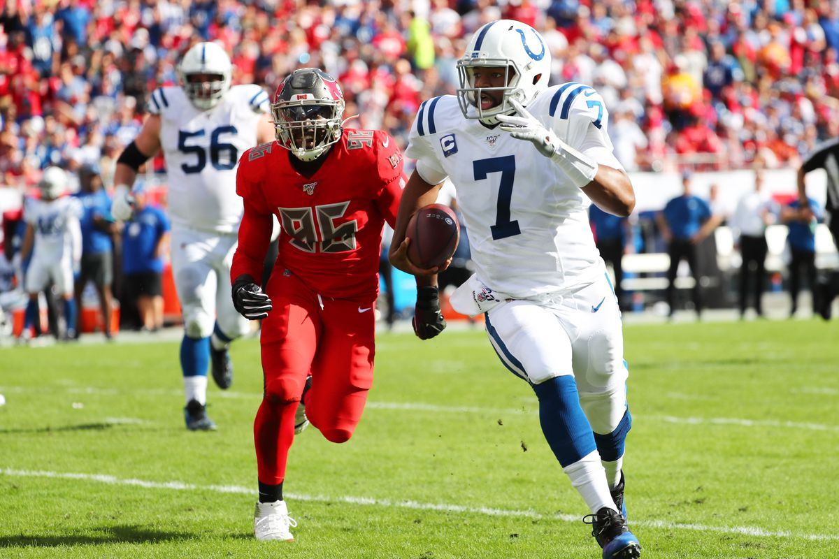 Indianapolis Colts quarterback Jacoby Brissett runs with the ball as Tampa Bay Buccaneers linebacker Sam Acho defends during the first half at Raymond James Stadium