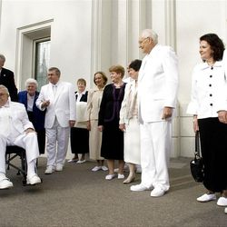 Elder Packer waves toward the crowd as he and the group return to the temple after the cornerstone ceremony. About 200 take part in the cornerstone ceremony at the Brigham City Temple prior to the dedication Sunday, Sept. 23, 2012.