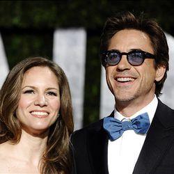 Robert Downey Jr. and wife Susan arrive at the Vanity Fair Oscar party on Sunday.