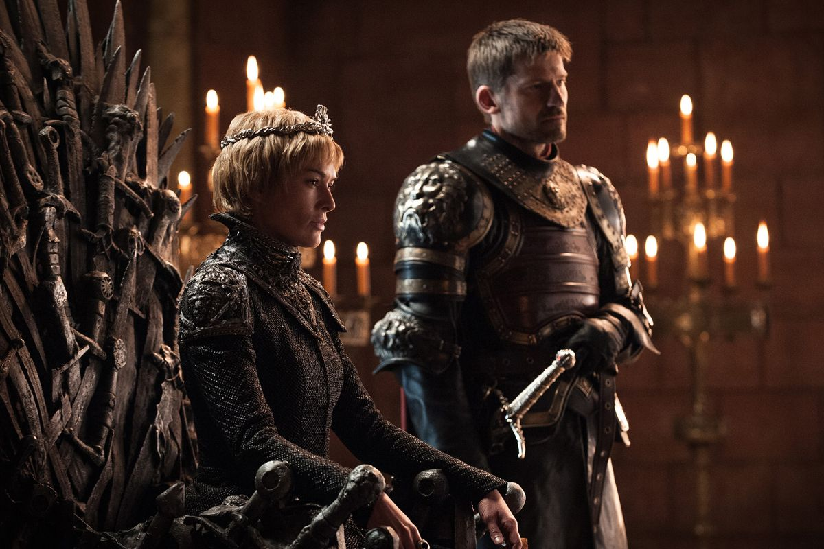 Cersei Lannister sits on the iron throne with her brother/lover Jaime standing beside her.