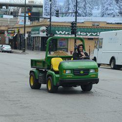 1:58 p.m. Grounds crew cart on Addison -