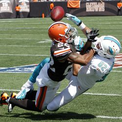 Sep 8, 2013; Cleveland, OH, USA; Cleveland Browns cornerback Buster Skrine (22) breaks up a pass intended for Miami Dolphins wide receiver Brian Hartline (82) during the first quarter at FirstEnergy Field.
