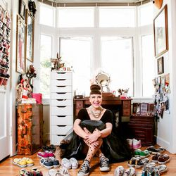 Amanda surrounded by her Chuck Taylor collection.