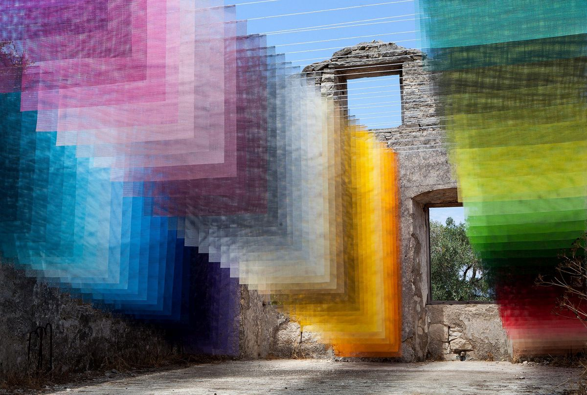 Pieces of colorful layered fabric in old courtyard
