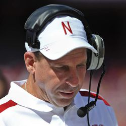 Nebraska head coach Bo Pelini looks down in the first half of an NCAA college football game against Arkansas State in Lincoln, Neb., Saturday, Sept. 15, 2012. Pelini left the game by ambulance after falling ill on the sideline in the first half.