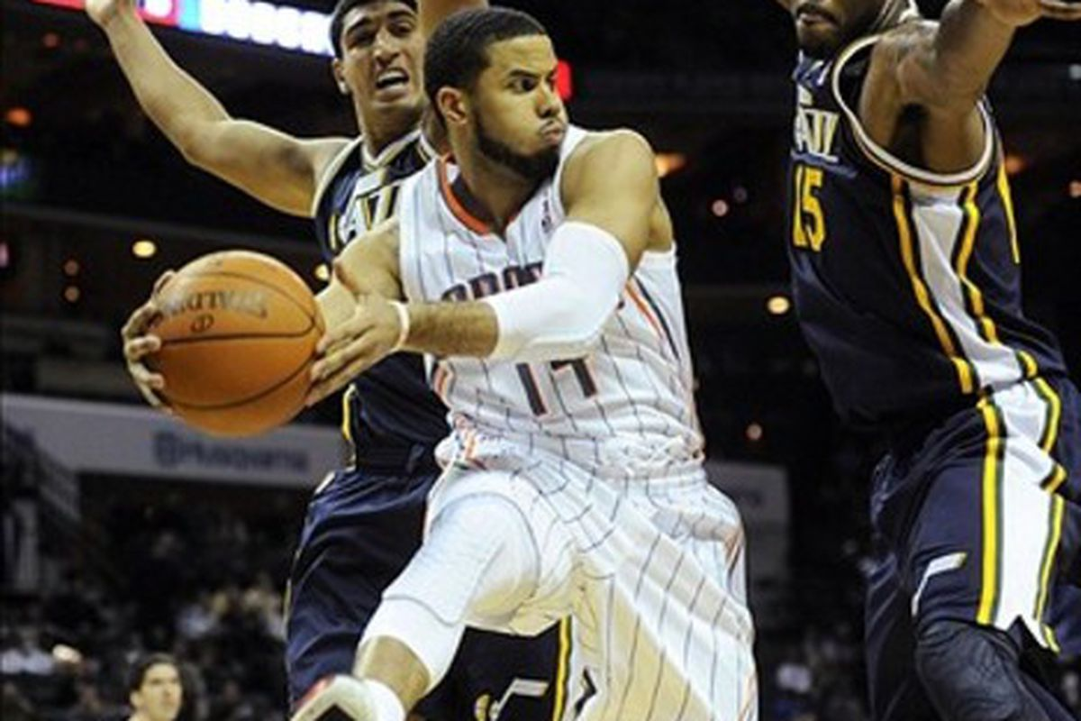 March 7, 2012; Charlotte, NC, USA; Charlotte Bobcats guard D.J. Augustin (14) passes the ball during the game against the Utah Jazz at Time Warner Cable Arena. Mandatory Credit: Sam Sharpe-US PRESSWIRE