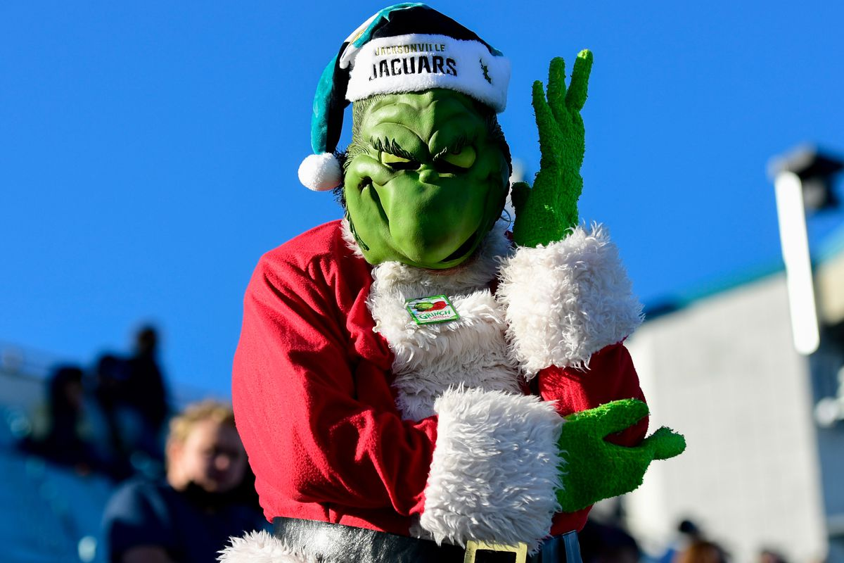 A fan dresses in a Grinch costume during the second half of a game between the Jacksonville Jaguars and the Chicago Bears at TIAA Bank Field.