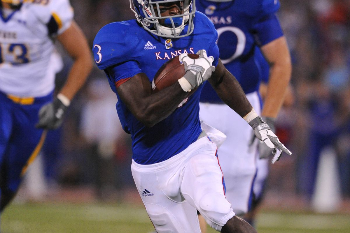 Sep 1, 2012; Lawrence, KS, USA; Kansas Jayhawks halfback Tony Pierson (3) rushes for a touchdown against the South Dakota State Jackrabbits in the second half at Memorial Stadium. Kansas won the game 31-17. Mandatory Credit: John Rieger-US PRESSWIRE