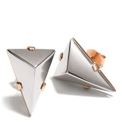 """<a href=""""http://f.curbed.cc/f/Coach_111913_StudEarrings"""">Small Pyramid Stud Earrings</a>, $78"""