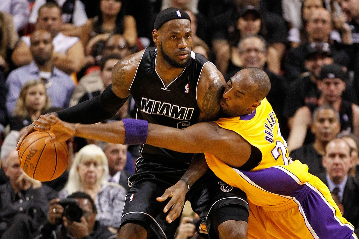 MIAMI, FL - JANUARY 19: LeBron James #6 of the Miami Heat is guarded by Kobe Bryant #24 of the Los Angeles Lakers during a game at American Airlines Arena on January 19, 2012 in Miami, Florida. (Photo by Mike Ehrmann/Getty Images)