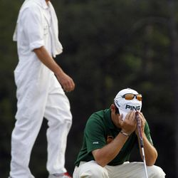 Louis Oosthuizen, of South Africa, reacts after missing a putt during a sudden death playoff on the 10th hole the Masters golf tournament Sunday, April 8, 2012, in Augusta, Ga.