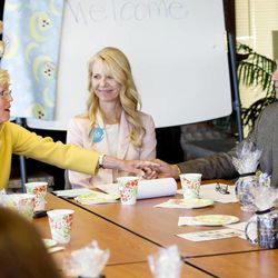 Sister Rosemary M. Wixom, general Primary president of the LDS Church, thanks Children's Justice Center program manager Susanne Mitchell and Salt Lake County District Attorney Sim Gill for their work for abused children after a tour of the Avenues Children's Justice Center Tuesday, April 28, 2015, in Salt Lake City.