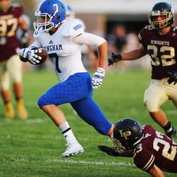 Bingham's Brayden Cosper runs out of a tackle by Lone Peak's Tanner hansen as they play in Highland on Friday, Sept. 2, 2016.