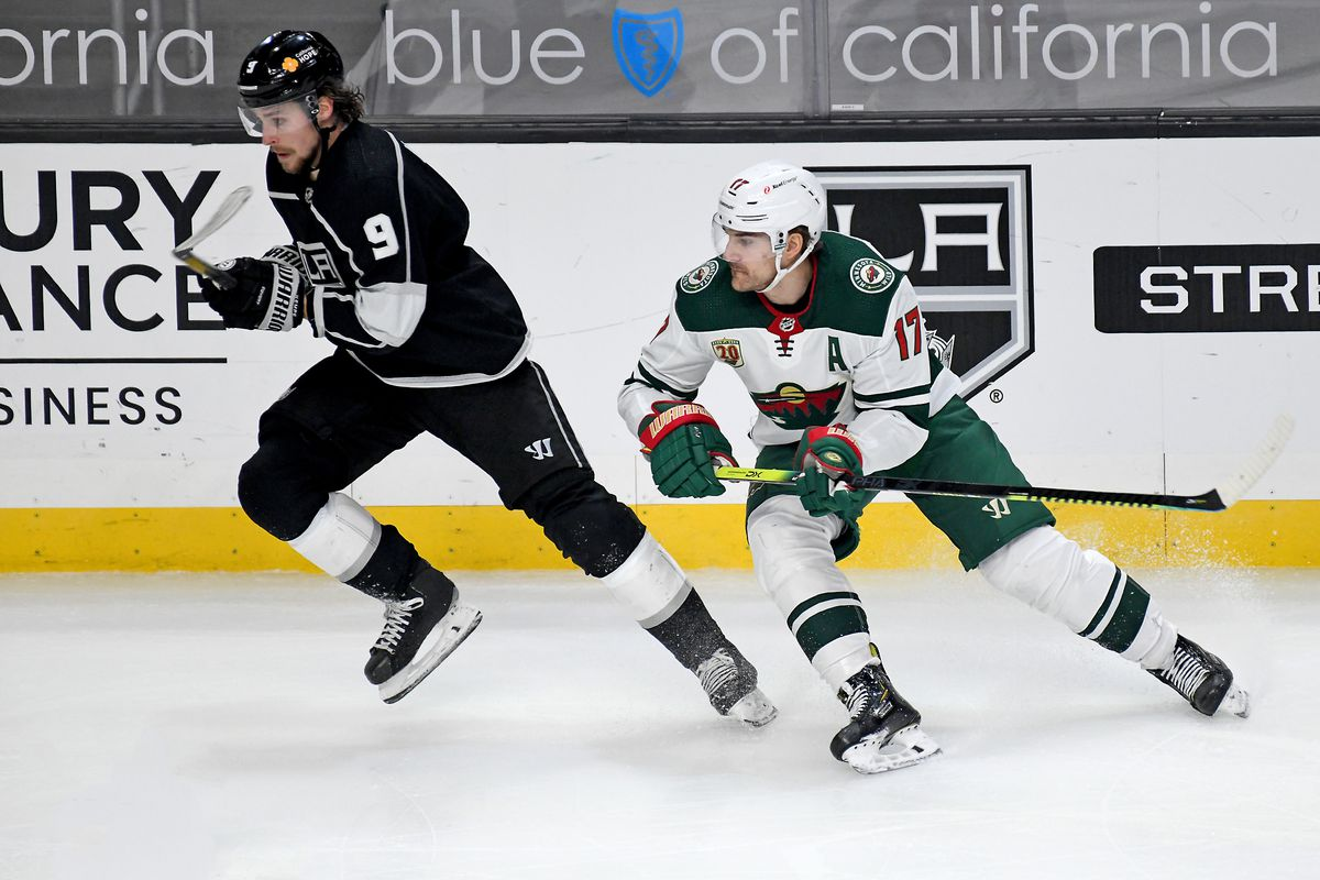 Los Angeles Kings Winger Adrian Kempe (9) and Minnesota Wild forward Marcus Foligno (17) skate into the play during an NHL game between the Minnesota Wild and the Los Angeles Kings on February 16, 2021, at the Staples Center in Los Angeles, CA.