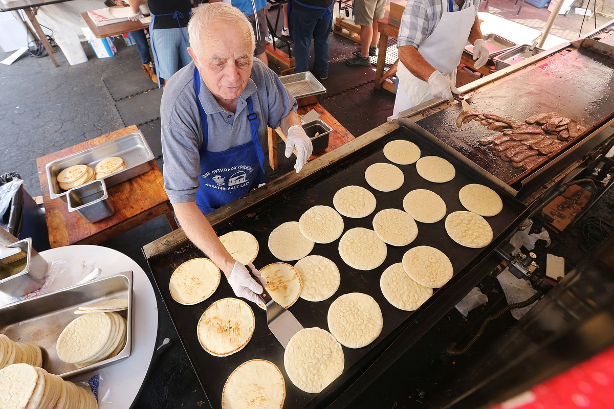 Mike Giamalakis heats pitas at the 42nd annual Greek Festival in Salt Lake City on Sunday, Sept. 10, 2017. This year's festival is set for Sept. 7 through 9.
