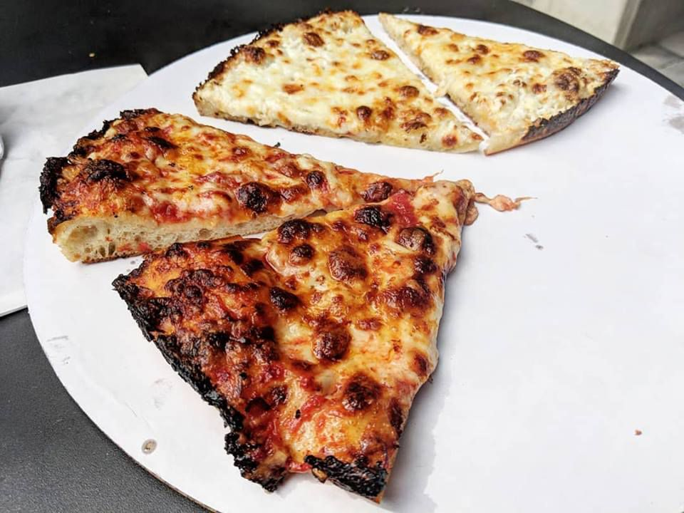 A few slices of cheese and the whitey pizza at Hot Box (note: only whole pizzas are available, not slices)