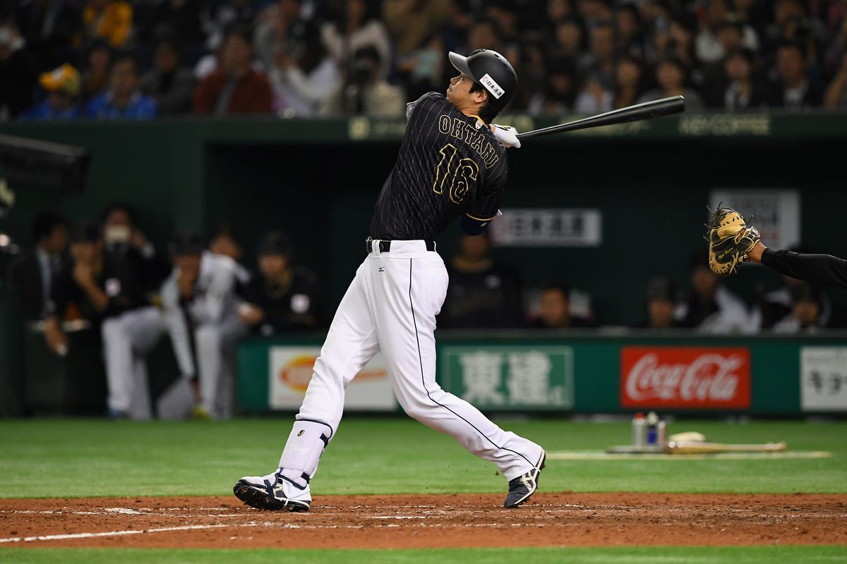 TOKYO, JAPAN - NOVEMBER 13:  Pinch hitter Shohei Ohtani #16 of Japan hits a double, which is stuck on ceiling of the stadium, in the seventh inning during the international friendly match between Netherlands and Japan at the Tokyo Dome on November 13, 2016 in Tokyo, Japan.  (Photo by Masterpress/Getty Images)