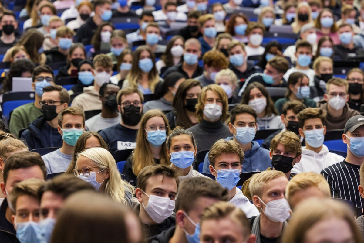 Students wear mouth-to-nose coverings in Muenster, Germany.
