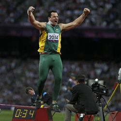 Australia's Todd Hodgetts celebrates after a world record throw in the men's Shot Put F20 final at the 2012 Paralympics, Friday, Sept. 7, 2012, in London. Hodgetts won gold in the event.