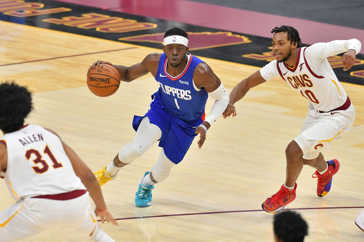 Reggie Jackson #1 of the LA Clippers drives to the basket around Darius Garland #10 of the Cleveland Cavaliers during the third quarter at Rocket Mortgage Fieldhouse on February 03, 2021 in Cleveland, Ohio.
