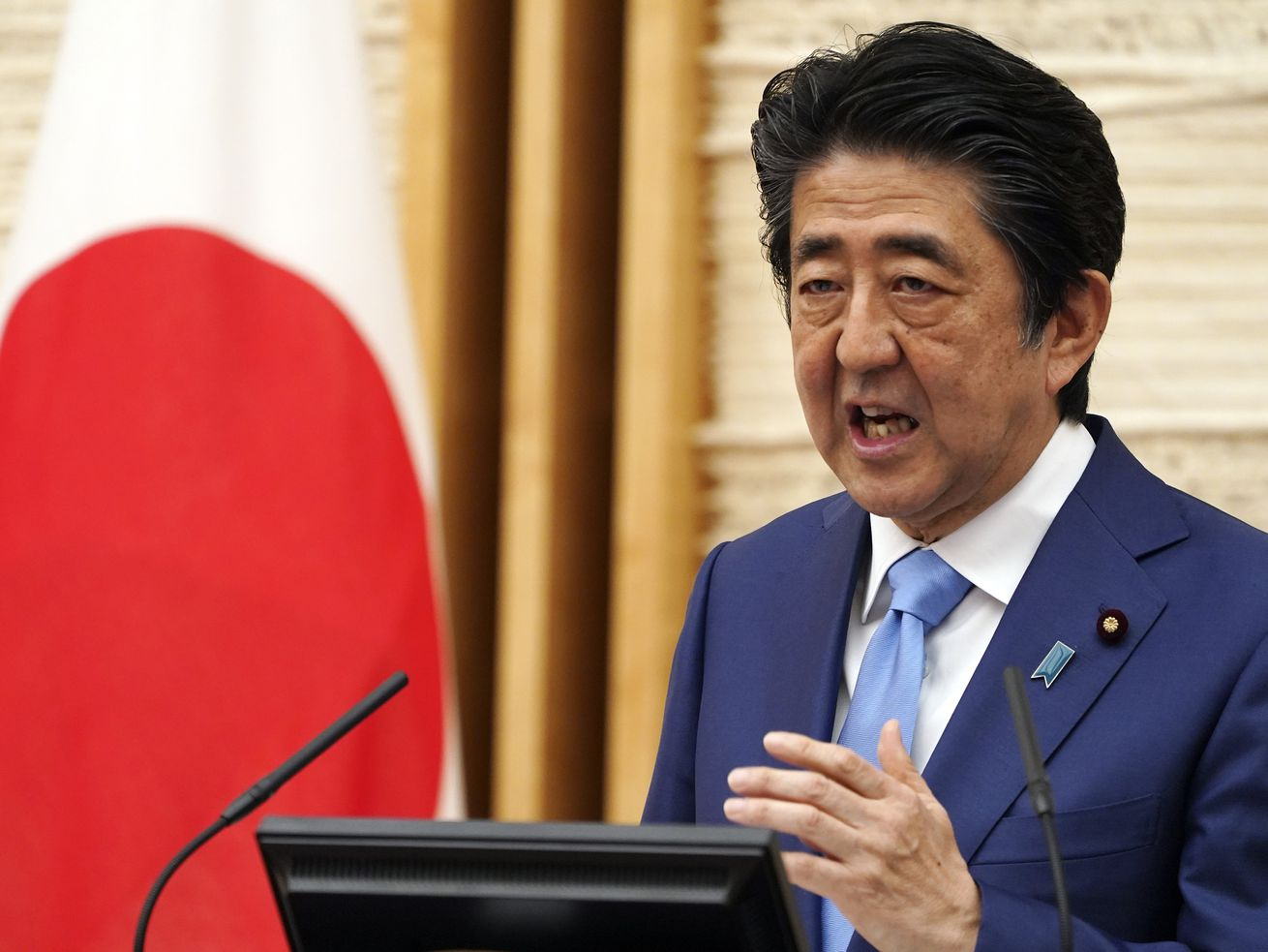Japan's NHK and other media say Friday, Aug. 28, 2020, Prime Minister Shinzo Abe has expressed his intention to step down, citing his health. In this May 4, 2020, file photo, Abe speaks during a press conference at his official residence in Tokyo.
