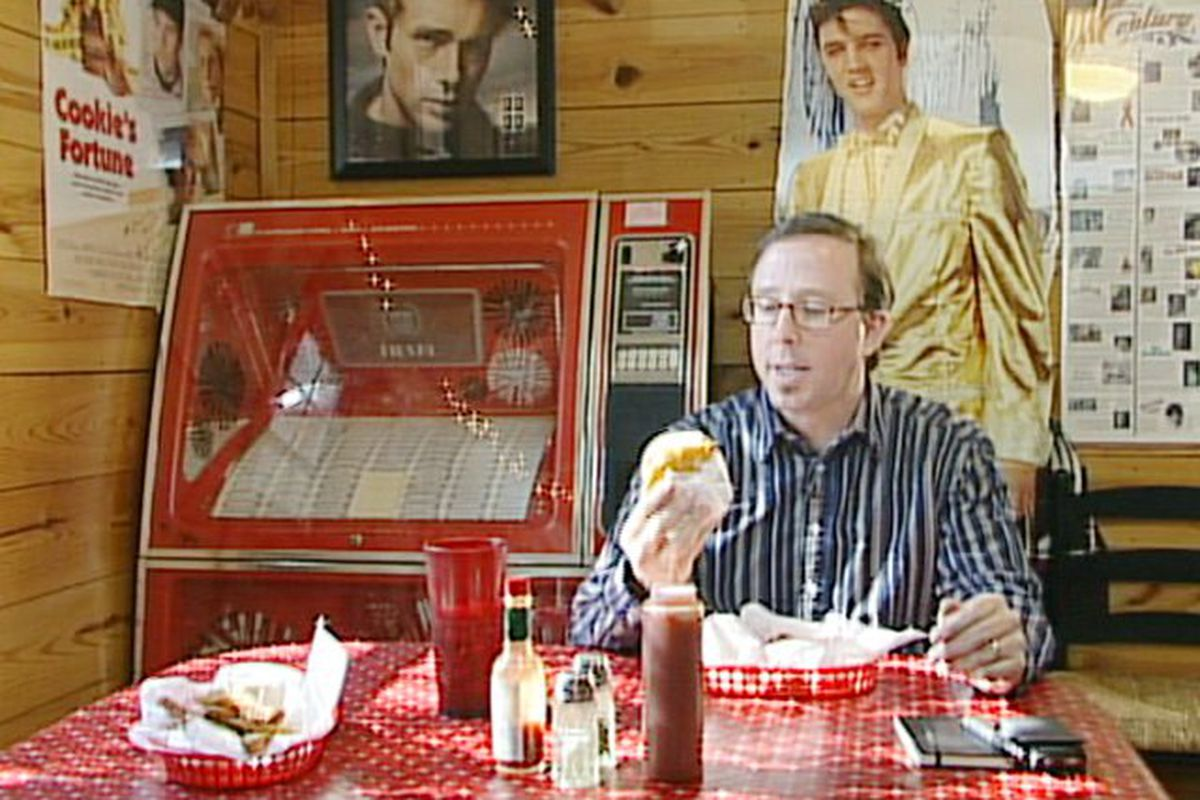John T. Edge with his friends, James Dean, Elvis and a burger.