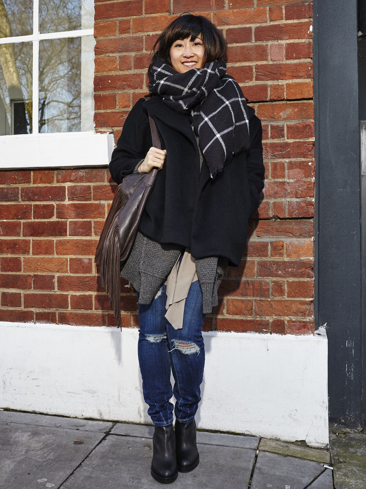 a4947977 Miyon Im, Head of Product, is wearing a Zara coat, a Gucci cardigan, a  Maison Margiela vest, a COS T-shirt, Current/Elliott jeans, Acne boots, a  Zara bag, a ...